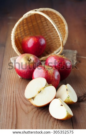 Organic fresh red apples on rustic wooden background, selective focus. Harvest time - stock photo