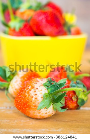 Organic fresh strawberries on old wooden background