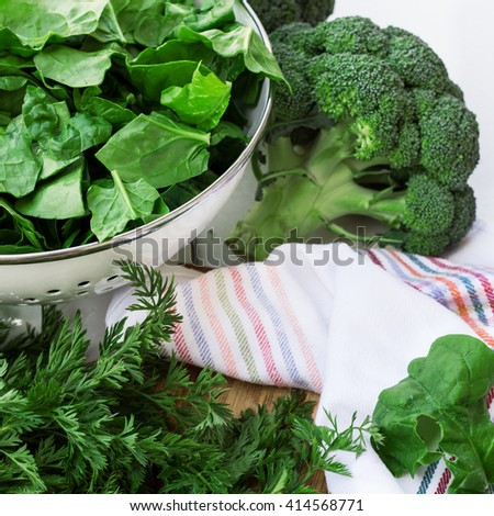 Organic fresh vegetables on a white table. Ingredients for spring soup. Selective focus - stock photo