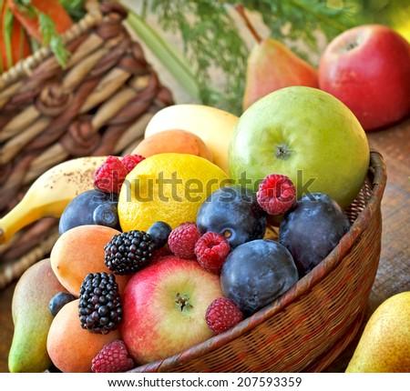 Organic fruit in wicker basket - stock photo