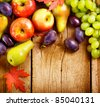 Organic Fruits over wood background. Autumn harvest - stock photo