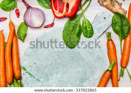 Organic garden vegetables ingredients around round cutting board , top view, copy space.  Healthy  food  and diet  nutrition concept. - stock photo