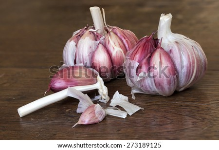 Organic garlic on a wooden table - stock photo