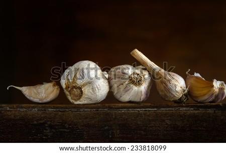 organic garlic on wooden board - stock photo