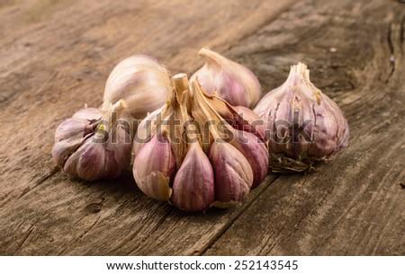 Organic garlic whole on the wooden background - stock photo