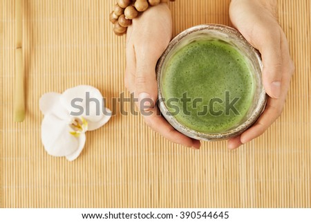 Organic green matcha tea top view. Matcha green tea on wooden table on background. - stock photo