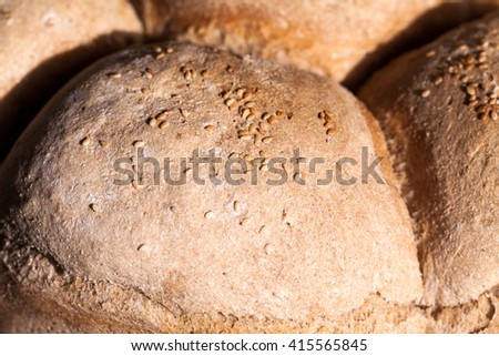 Organic home made bread with flax seeds and rural background