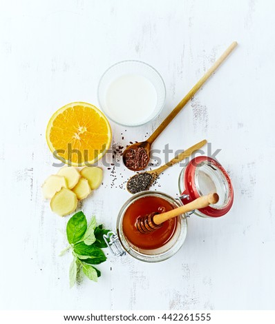 Organic Ingredients for Orange and Ginger Smoothie with Almond Milk (detox smoothie)   - stock photo