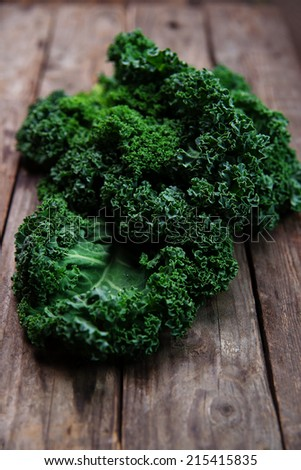 Organic kale with on old wooden background - stock photo