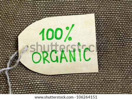 Organic label on the natural  burlap background - stock photo