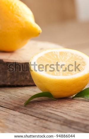 Organic  lemon fruit on nature wooden background - stock photo