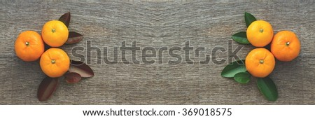 Organic mandarin on beautiful wooden table. healthy eating for healthy living. two side creative background for work space, website, book.    - stock photo