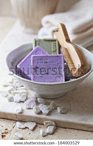 Organic Marseilles Soaps and Brush in a Ceramic Bowl - stock photo