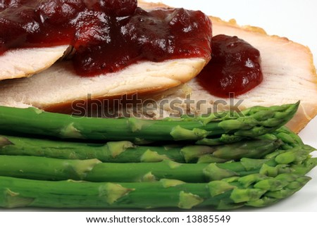 organic oven roasted turkey with cranberry sauce and asparagus - stock photo