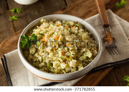 Organic Paleo Cauliflower Rice with Herbs and Spices - stock photo