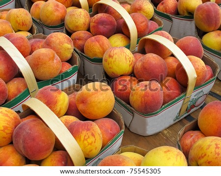 Organic Peaches for sale at farmers market - stock photo