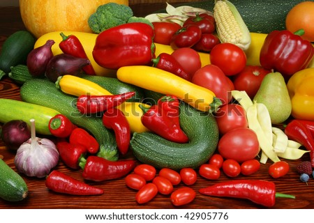 Organic produce. Autumn harvest - ripe vegetables and fruits. Tomatoes, plums, pepper, raspberries, zucchini, pears and other food. - stock photo