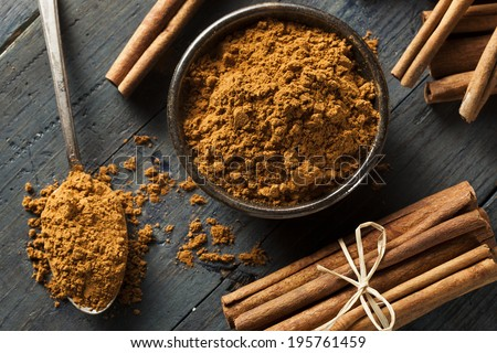 Organic Raw Brown Cinnamon on a Background - stock photo