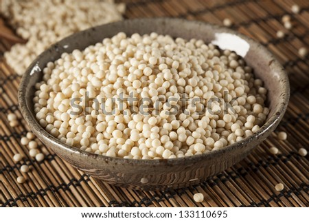 Organic Raw Middle Eastern Couscous against a background