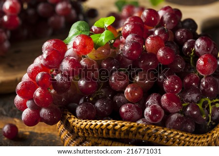 Organic Raw Red Grapes in a Basket - stock photo