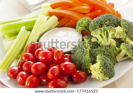 Organic Raw Vegetables with Ranch Dip with Tomatoes, Celery, Brocolli, and Carrots - stock photo