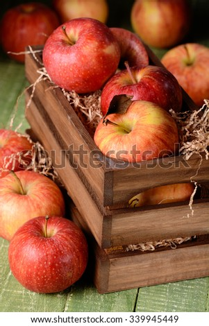 organic red apples in wooden box