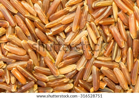 Organic Red Jasmine Rice (Red Hom Mali Rice); Macro Food Background - stock photo