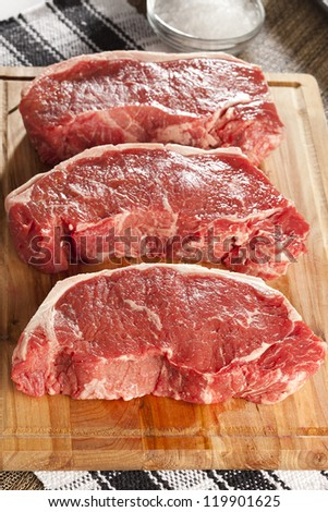 Organic Red Raw Steak Sirloin against a background - stock photo