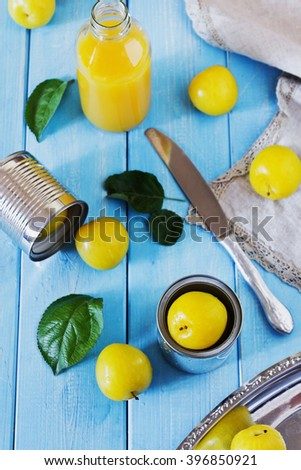 Organic ripe yellow plums on colorful wooden background .Bio healthy food concept. Selective focus. View from above. - stock photo