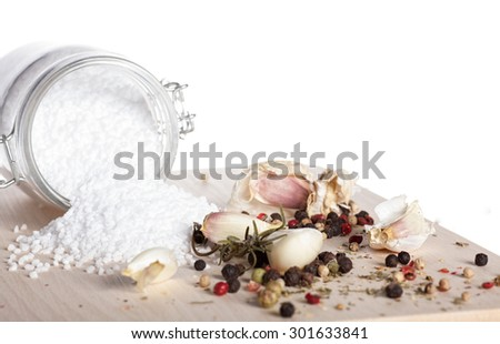 Organic sea salt and assorted spices over white background - stock photo