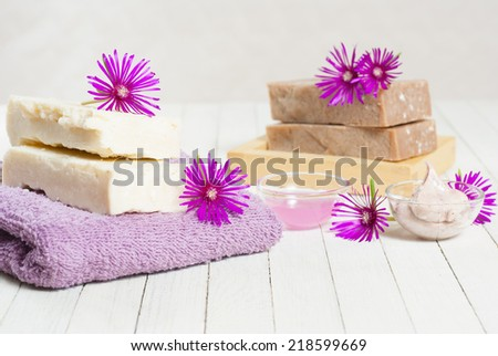 organic soaps and cosmetics with purple flowers on white wooden