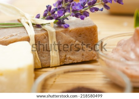 organic soaps with purple flowers on bamboo