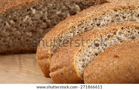 Organic spelt bread cut on slices, horizontal photo