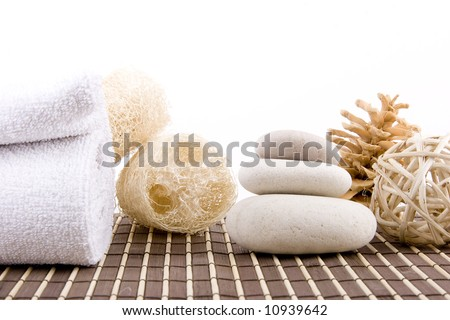 organic sponge, spa stones and white towel - stock photo