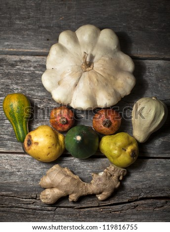 Organic squashes ginger on a rustic wooden board - stock photo