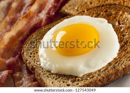 Organic Sunnyside up Egg with toast and bacon for breakfast - stock photo