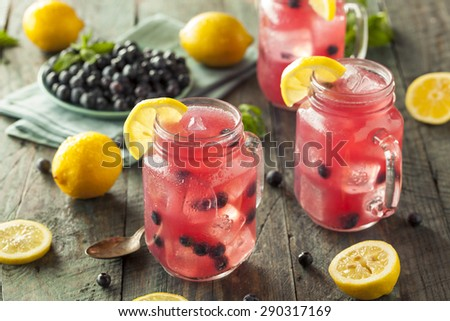 Organic Sweet Blueberry Lemonade in a Glass - stock photo