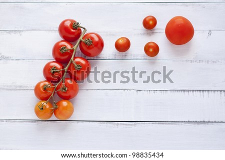 organic tomatoes and peppers against white table