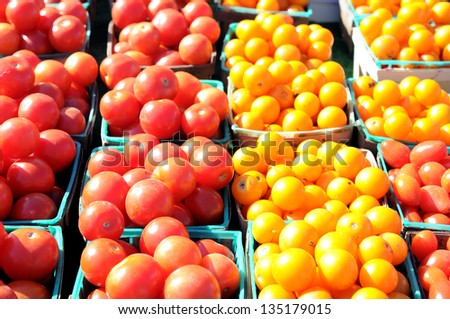organic tomatoes at outdoor market place in sunny day