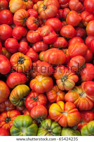 Organic tomatoes with irregular shape in red and green shades - stock photo