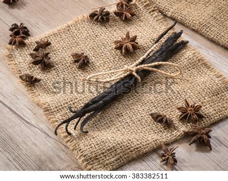Organic vanilla bean on sackcloth - stock photo