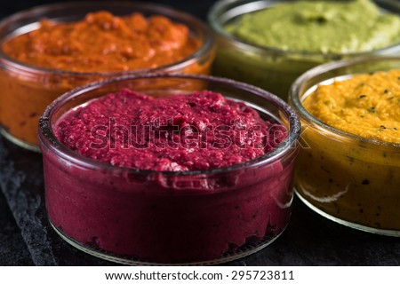 organic vegetable vibrant dip selection, food border background - stock photo