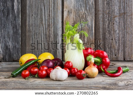 Organic vegetables and fruits on wooden background - stock photo