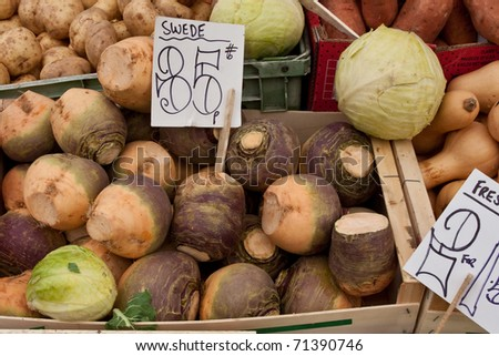 Organic vegetables at a market stall - stock photo