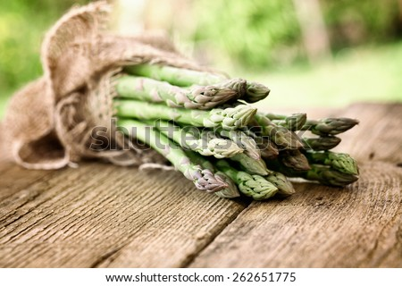 Organic vegetables. Fresh asparagus on wood. Fresh food - stock photo