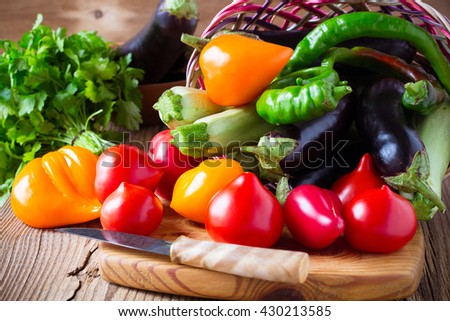 Organic vegetables in the basket on wooden table, healthy food concept - stock photo