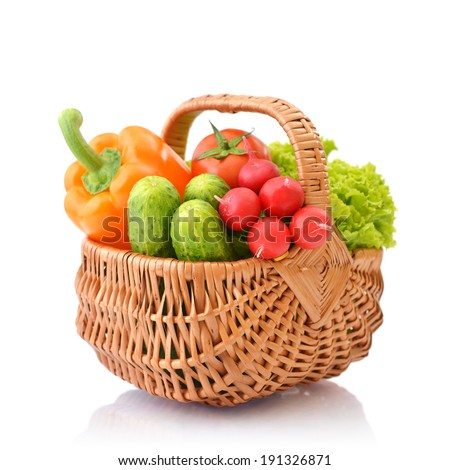 Organic vegetables in the wicker basket isolated on white background - stock photo