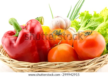 Organic vegetables in the wicker basket on white background