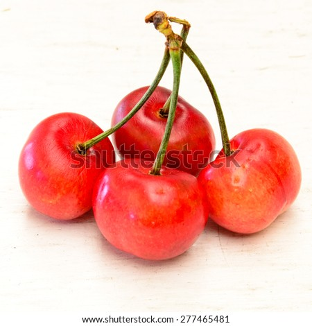 Organically grown bing cherries on the white background. These cherries are grown in California, USA. - stock photo