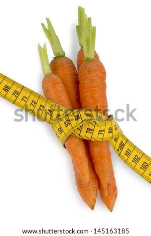 organically grown carrots with tape. fresh fruit and vegetables are always healthy. photo icon for healthy diet. - stock photo
